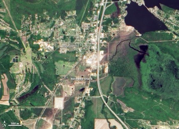 NASA's Aqua satellite saw a brown swath cut across an otherwise green landscape in Mayflower, Arkansas.  The satellite captured this image on May 2, 2014..