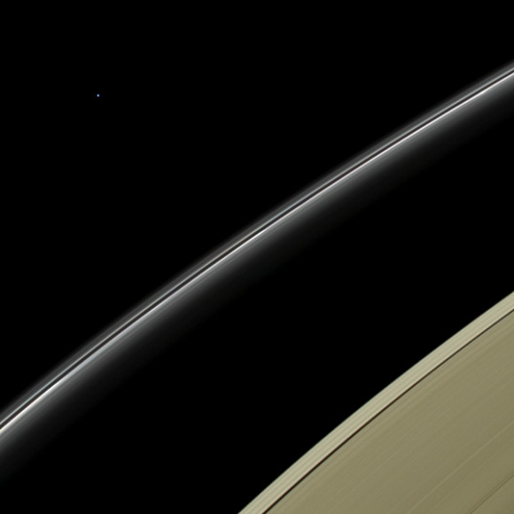 This view from NASA's Cassini spacecraft features a blue planet, but unlike the view from July 19, 2013 (PIA17172) that featured our home planet, this blue orb is Uranus, imaged by Cassini for the first time. Credit: NASA/JPL-Caltech/Space Science Institute