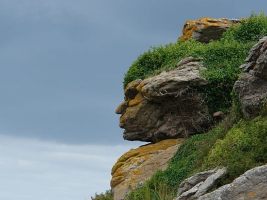 Pareidolia of an Apache head in rocks, in Ebihens, France via Wikimedia Commons.
