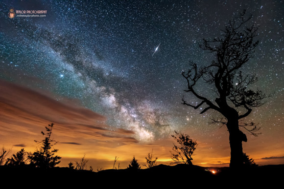 Nature & Man: Iridium Flare, Milky Way, Clouds and Light Pollution by Mike Taylor.  Visit Mike Taylor Photography.