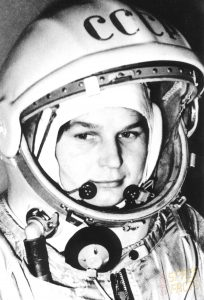 Woman in spacesuit, black and white.