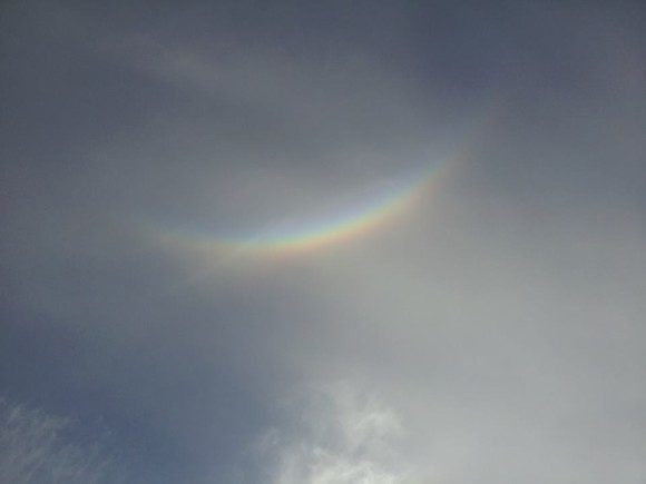 Semi-cloudy sky with fainter circumzenithal arc high up.