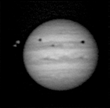 Jupiter and three moon shadows, photographed by Rudolf Hillebrecht in Germany on June 3, 2014.