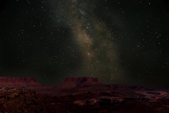 Deep purple flat-topped mesas under a starry sky.