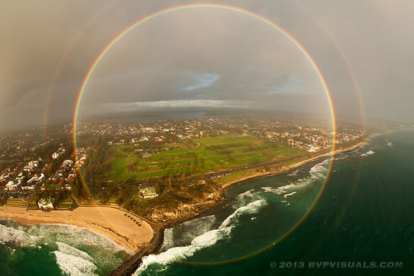 View larger. | Full circle rainbow was captured over Cottesloe Beach near Perth, Australia in 2013 by Colin Leonhardt of Birdseye View Photography.  He was in a helicopter flying between a setting sun and a downpour.   Used with permission.  Order prints of this photo.