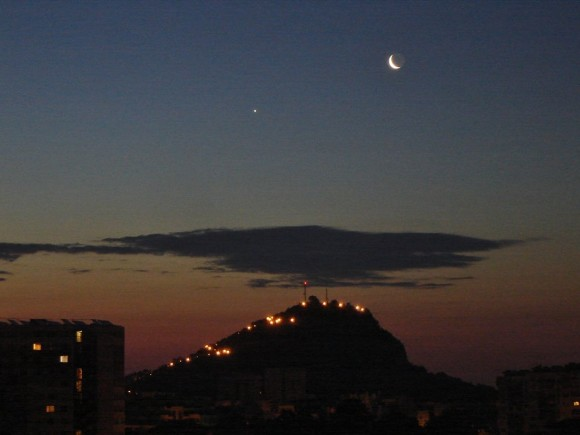 Boris Vecev caught the moon and Venus over a hill in Plovdiv, Bulgaria, on June 24.  Thank you, Boris!
