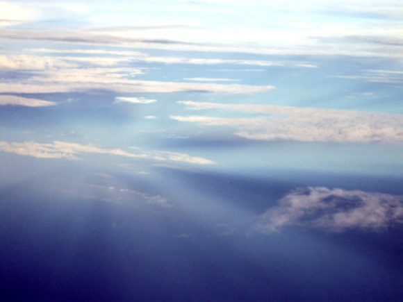 Anticrepuscular rays over the Pacific, viewed from an aircraft.  Photo by Geoffrey A. Landis, September 11, 2007, via Wikimedia Commons.