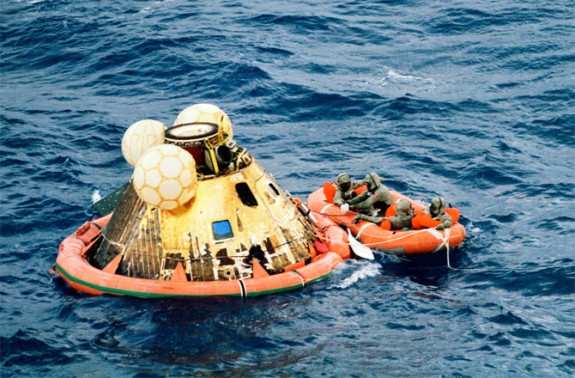 Floating conical module, inflated orange collar at base, yellow inflated balls at top, & orange raft.