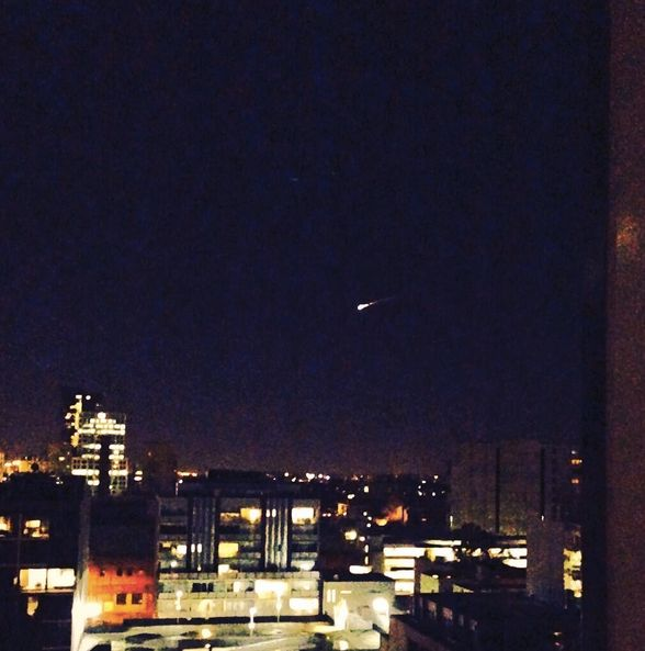 Bright meteor over the city of Melbourne, Australia on July 10, 2014 via Nathalie J. Berger (@najube).