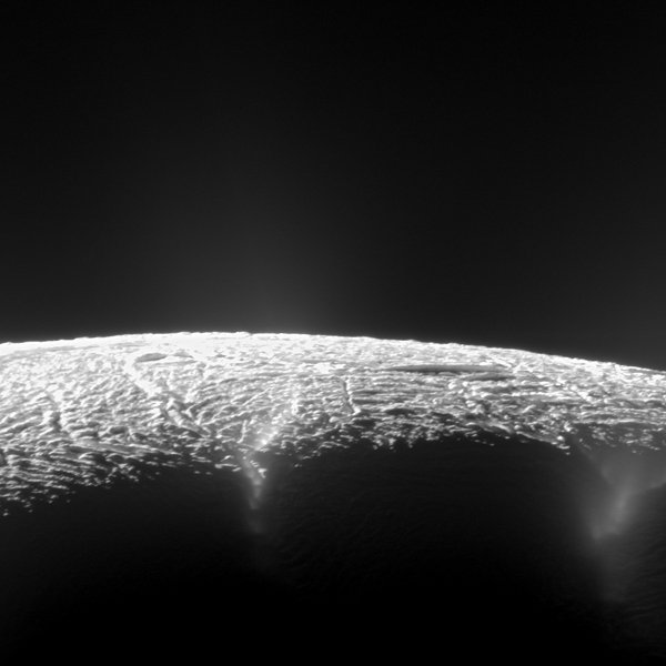 This view looks across the geyser basin of Saturn's moon Enceladus, along fractures spewing water vapor and ice particles into space. Cassini scientists have pinpointed the source locations of about 100 geysers and gained new insights into what powers them. Image credit: NASA/JPL-Caltech/SSI