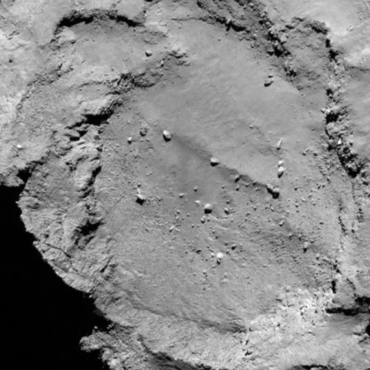 Landing site B, smaller lobe of comet, a crater on the comet's