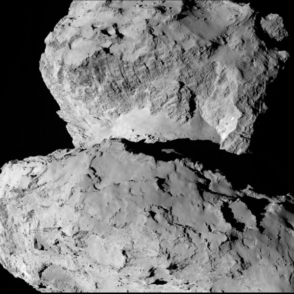 Comet 67P/Churyumov–Gerasimenko on August 7, 2014 at a distance of 104 kilometers / 64.5 miles by the Rosetta Mission OSIRIS NAC Camera.  Looking from the larger lobe, over the 'neck', to the smaller lobe.  These are a pair of images taken 17 minutes apart to form a stereo pair for the 3D image above, part of the investigation in the search for a landing site for the Philae lander.  Full article, both images and 3D anaglyph here.