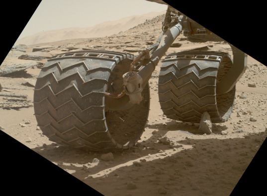 View larger. | A routine wheel survey on sol 631 found the right rear wheel perched atop a spike-shaped rock firmly embedded in the ground.