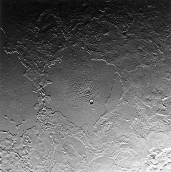 On Triton, Ruach Planitia, a frozen lake.  Image via Voyager 2.