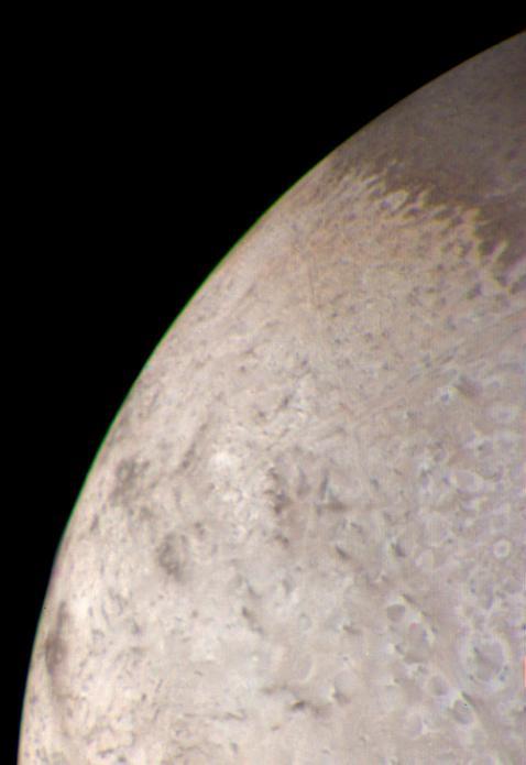 The limb (edge) of Triton in color via Voyager 2.