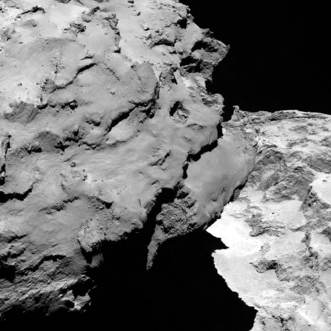 Close-up detail of comet 67P/Churyumov-Gerasimenko. The image was taken by Rosetta's OSIRIS narrow-angle camera and downloaded on August 6, 2014. The image shows the comet's 'head' at the left of the frame, which is casting shadow onto the 'neck' and 'body' to the right.  The image was taken from a distance of 120 km and the image resolution is 2.2 meters per pixel.  Via ESA Rosetta mission image page.