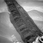 """Mars rover Curiosity's tracks in Mars' """"Hidden Valley.""""  Image via NASA"""
