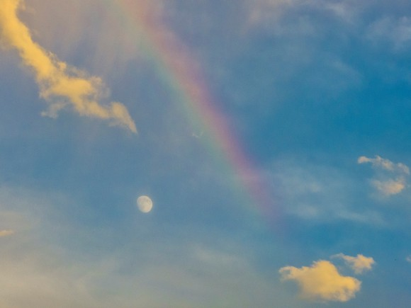 Waxing gibbous moon on August 7, 2014, with a portion of a rainbow, by Kimmie Randall
