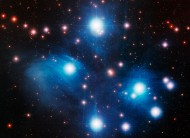 A telescopic view of the Pleiades, or Seven Sisters.  The eye sees this cluster as a tiny, misty dipper of stars.  It is one of the most beloved star clusters.  Image via NOAO/AURA/NSF.