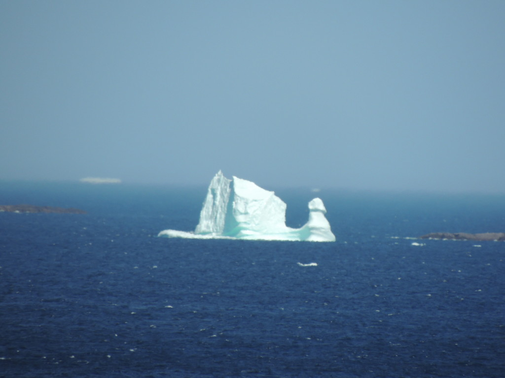 "A ""sailing ship"" iceberg off the coast of Fogo Island, July 17, 2014.  Photo credit: Bonnie J. McCay"