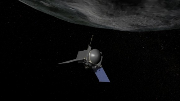 Artist's concept of NASA's OSIRIS-REx spacecraft preparing to take a sample from asteroid Bennu.  Image via NASA/Goddard