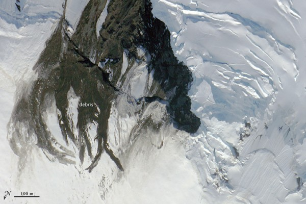 This photo was taken on July 16, one day before the earthquake. Rocks and debris from a previous landslide litter the young, steep slopes alongside Seward Glacier.  NASA Earth Observatory images created by Jesse Allen, using digital photographs provided by Kelly Brunt, MABEL campaign.