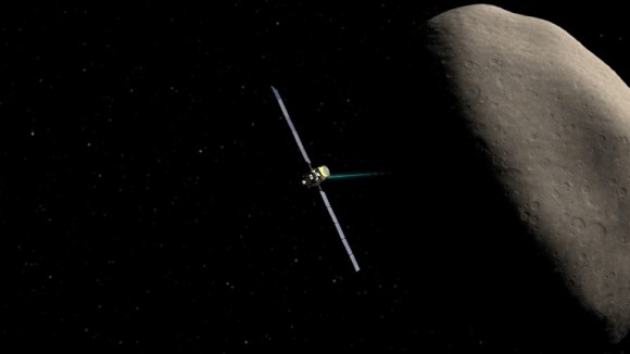 Artist's concept of Dawn spacecraft at asteroid Ceres.  Due to this setback, the craft is now scheduled to arrive at Ceres in April 2015, a month later than planned.  Image via NASA/JPL-Caltech/UCLA
