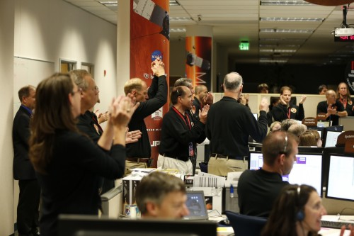 Scientists cheer as the successful orbit insertion for Mars MAVEN is confirmed.  Image via Lockheed Martin