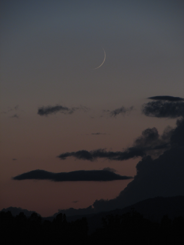 Young moon - a waxing crescent in the west after sunset - captured by Spencer Mann in Davis, California on September 25, 2014.