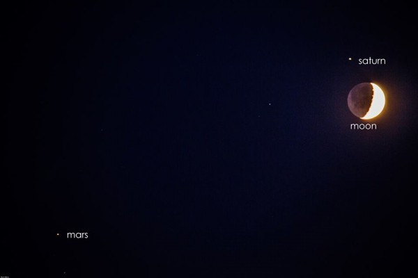Marco Mereu in Italy caught the moon, Saturn and Mars on August 31, 2014.