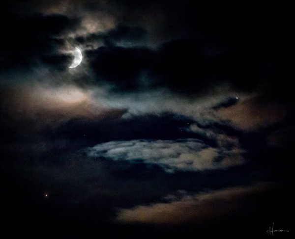 Keith Hanssen caught the planets and moon on August 31 through thin clouds over southwestern Montana.