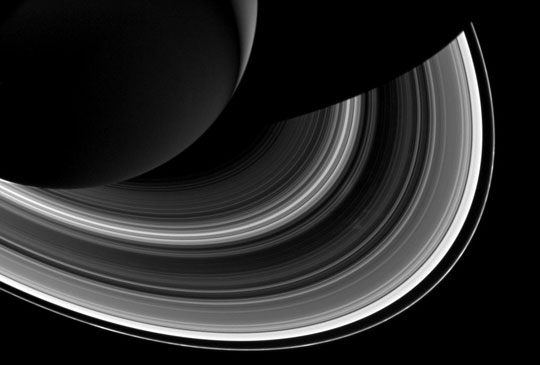 Cassini spied just as many regular, faint clumps in Saturn's narrow F ring (the outermost, thin ring), like those pictured here, as Voyager did. But it saw hardly any of the long, bright clumps that were common in Voyager images.  Image via Cassini.