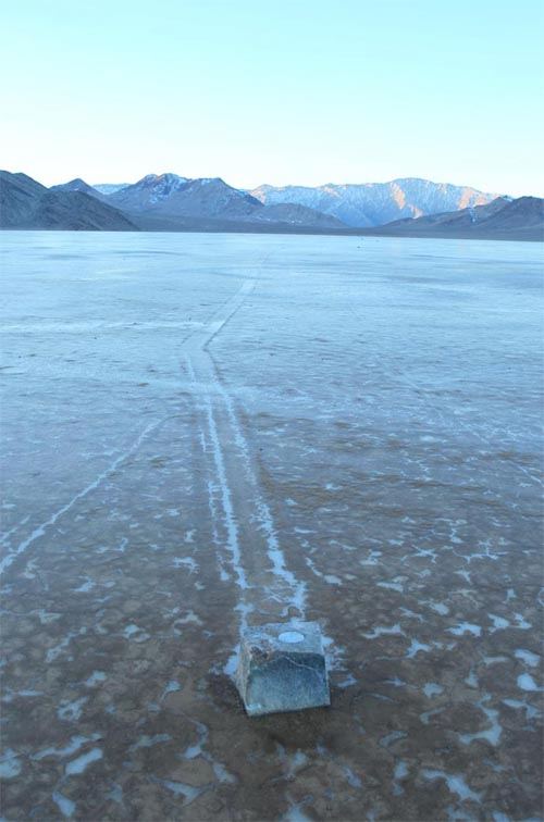 One of the GPS-instrumented rocks and its track across Racetrack Playa. The GPS unit, with its battery pack, was placed in a cavity bored into the top of the rock.  Photo via PLOS ONE.