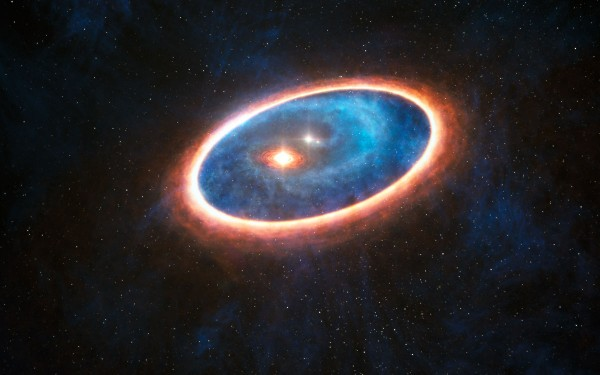 View larger. |  This artist's impression shows the dust and gas around the double star system GG Tauri-A. Researchers using ALMA have detected gas in the region between two discs in this binary system. This may allow planets to form in the gravitationally perturbed environment of the binary. Half of Sun-like stars are born in binary systems, meaning that these findings will have major consequences for the hunt for exoplanets.  Image via ESO/L. Calçada