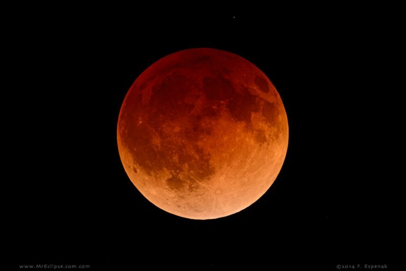Large orange-red eclipsed moon.