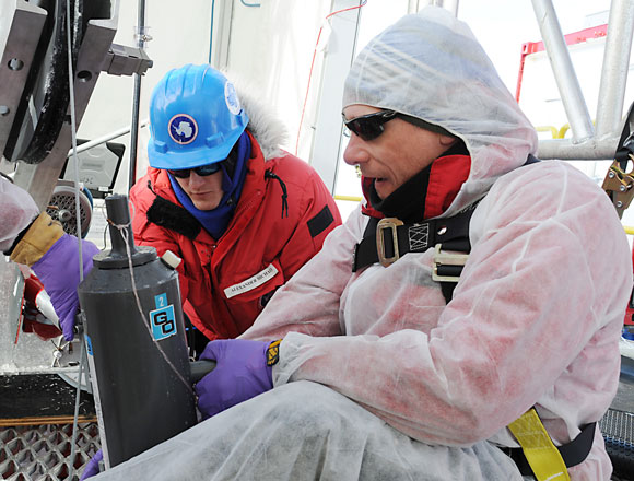 Brent Christner and Alex Michaud retrieve the first water sample from Lake Whillans. Image Credit: Reed Scherer, Northern Illinois University.