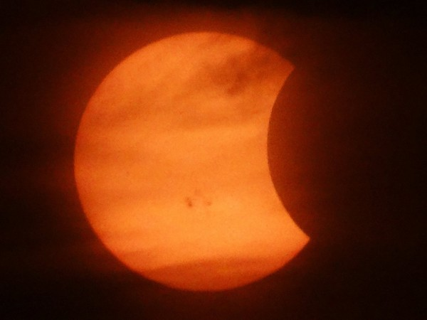 Solar eclipse through thin clouds by Carl Galloway in Indiana.  Thanks, Carl.