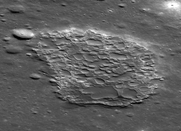The feature called Ina is about 2 miles long by 1.2 miles wide (2 by 3 km) and 160 feet (50 meters) deep. Its floor is covered with many small, low lava mounds. The number of craters seen on the mounds indicates that the eruptions happened about 33 million years ago. Photo credit: NASA/GSFC/Arizona State University