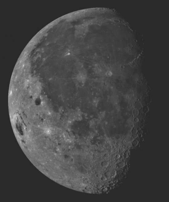 A vast dark lava plain on the moon, rimmed with rocky features.