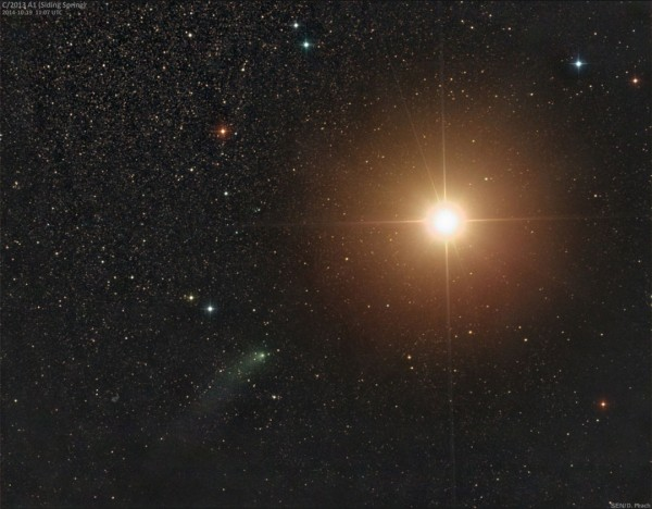 Comet Siding Spring (lower left) passes Mars on October 19, 2014.  Photo by Damian Peach.  Used with permission.