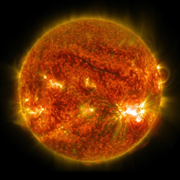 The bright light in the lower right of the sun shows an X-class solar flare on Oct. 26, 2014, as captured by NASA's SDO. This was the third X-class flare in 48 hours, which erupted from the largest active region seen on the sun in 24 years. Image credit: NASA/SDO