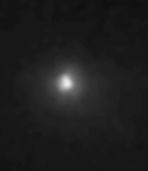 Screen dump from the video of a NASA broadcast about the very close pass by Mars of the comet C/2013 A1 Siding Spring. A fully resolved image of Comet Siding Spring nucleus in crescent phase as seen by MRO HiRISE. Image via NASA/JPL/University of Arizona.