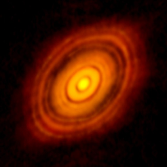 View larger. | ALMA image of the young star HL Tau and its protoplanetary disk. This best image ever of planet formation reveals multiple rings and gaps that herald the presence of emerging planets as they sweep their orbits clear of dust and gas. Credit: ALMA (NRAO/ESO/NAOJ); C. Brogan, B. Saxton (NRAO/AUI/NSF)
