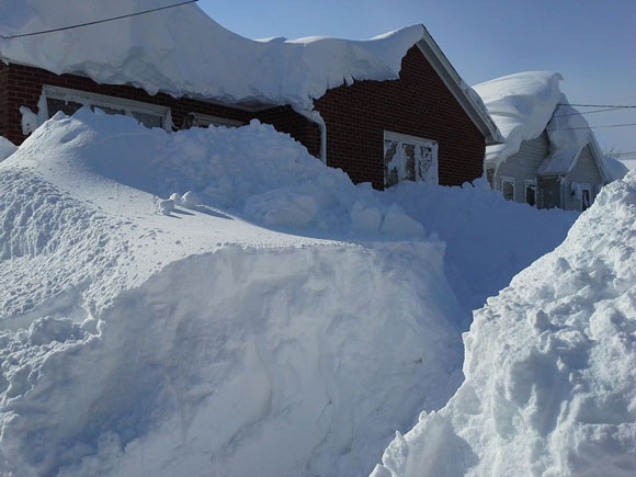 A house buried in the snow in Buffalo, NY on November 19, 2014. Image appears courtesy of Scott Stranahan.