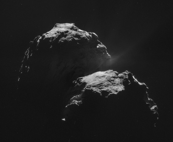 The night side of Comet 67P.  The resolution of this image mosaic of four NAVCAM images is about 2.68 meters, and the mosaic covers roughly 4.6 kilometers by 3.8 kilometers.   Image via Andrew R. Brown; read more about this image.