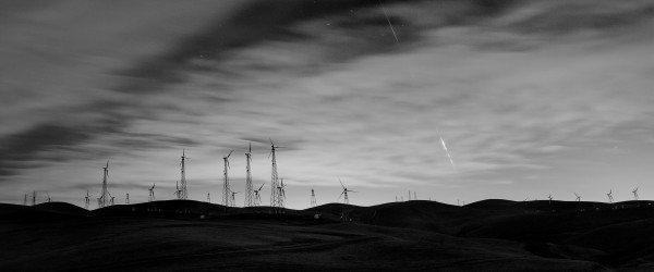 Robert Milton saw this Geminid fireball behind clouds, over a wind farm in the Bay area.