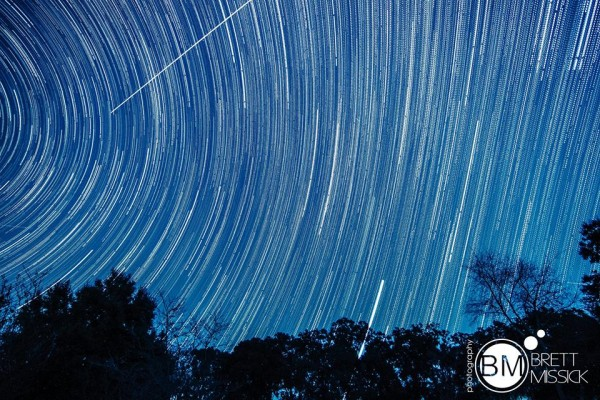 Star trails and the long streak of a Geminid meteor, by Brett Missick Photography.