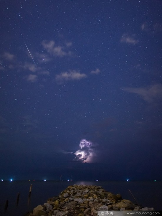 Mau Horng caught a Geminid meteor with lightning at Balik Pulau, Penang, Malaysia.  He wrote: