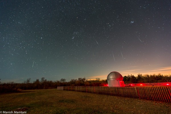 Manish Mamtani caught this Geminid meteor on the night of December 13, 2014.  He was at Frosty Drew Observatory and Sky Theatre in Charlestown, Rhode Island.