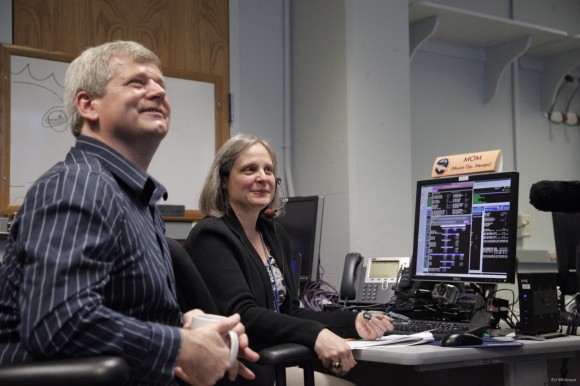 Happy New Horizons Mission Operations Manager Alice Bowman and operations team member Karl Whittenburg watch the screens for data confirming that the New Horizons spacecraft had transitioned from hibernation to active mode on December 6. Photo credit: NASA